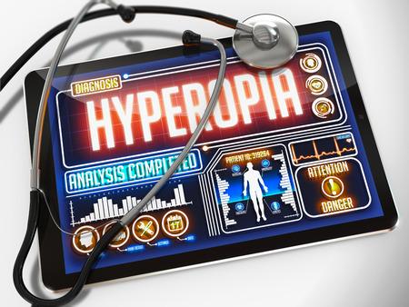 hyperopia: Ipermetropia - Diagnosi sul display di Tablet medico e uno stetoscopio nero su sfondo bianco.