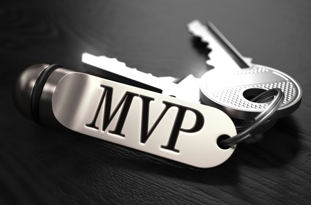 black and silver: MVP - Most Valuable Player - Concept. Keys with Keyring on Black Wooden Table. Closeup View, Selective Focus, 3D Render. Black and White Image. Stock Photo