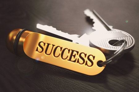 successful strategy: Keys to Success - Concept on Golden Keychain over Black Wooden Background. Closeup View, Selective Focus, 3D Render. Toned Image. Stock Photo