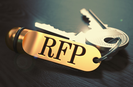 proposal: Keys and Golden Keyring with the Word RFP - Request for Proposal - over Black Wooden Table with Blur Effect. Toned Image. Stock Photo