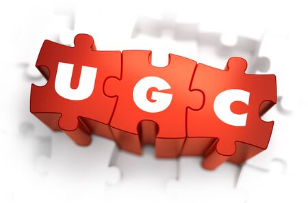 selective: Word - UGC - User Generated Content -  on Red Puzzle on White Background. Selective Focus. Stock Photo