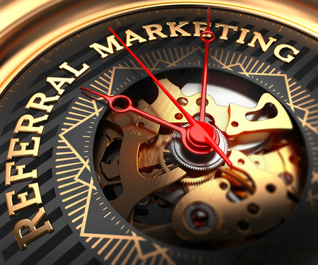 referral marketing: Referral Marketing on Black-Golden Watch Face with Watch Mechanism. Full Frame Closeup.