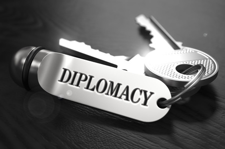 keyring: Diplomacy Concept. Keys with Keyring on Black Wooden Table. Closeup View, Selective Focus, 3D Render. Black and White Image.