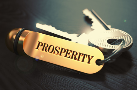 prosperidad: Teclas con Palabra Prosperidad sobre el Golden Label Negro sobre fondo de madera. Vista de cerca, foco selectivo, 3D rinden. Imagen virada.