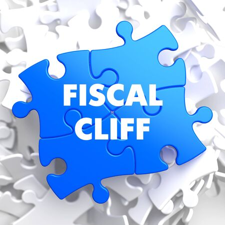 fiscal: Fiscal Cliff on Blue Puzzle on White Background. Stock Photo