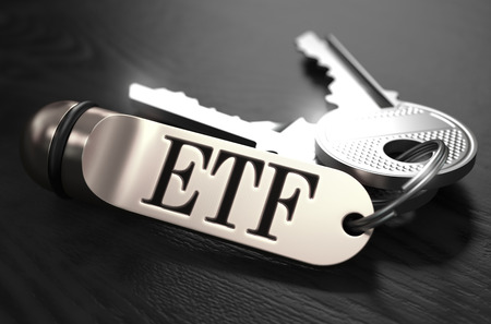 traded: ETF - Exchange Traded Fund - Concept. Keys with Keyring on Black Wooden Table. Closeup View, Selective Focus, 3D Render. Black and White Image.