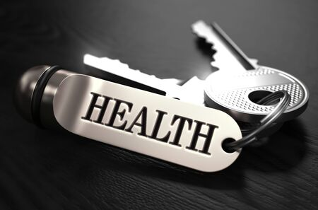 soundness: Keys to Health - Concept on Golden Keychain over Black Wooden Background. Closeup View, Selective Focus, 3D Render. Black and White Image. Stock Photo