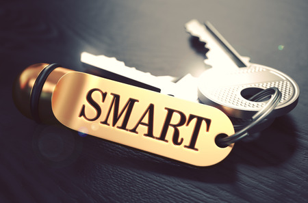knowledgeable: Smart - Bunch of Keys with Text on Golden Keychain. Black Wooden Background. Closeup View with Selective Focus. 3D Illustration. Toned Image.