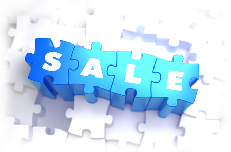 disposition: Sale - Text on Blue Puzzles on White Background.