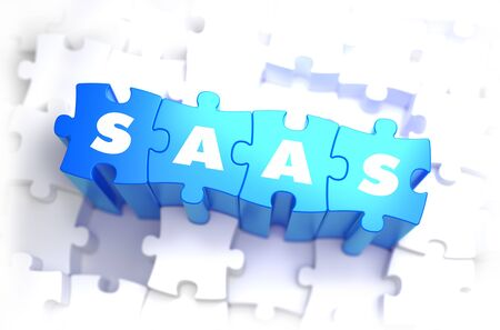 saas: SaaS - Software as a Service - Text on Blue Puzzles on White Background.  Stock Photo