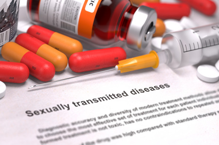 std: Sexually Transmitted Diseases - Printed Diagnosis with Red Pills, Injections and Syringe.
