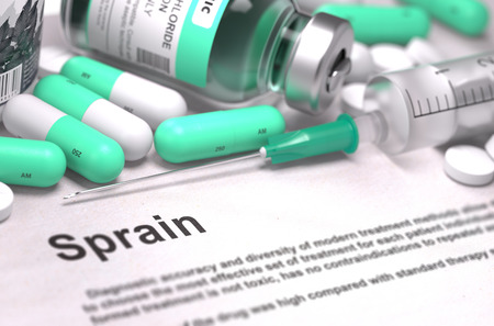 sprain: Sprain - Printed Diagnosis with Mint Green Pills, Injections and Syringe. Medical Concept with Selective Focus. Stock Photo