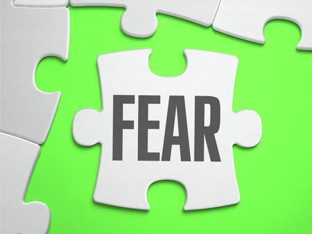 puzzle background: Fear - Jigsaw Puzzle with Missing Pieces. Bright Green Background. Stock Photo