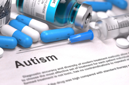 medical report: Diagnosis - Autism. Medical Report with Composition of Medicaments - Blue Pills, Injections and Syringe. Blurred Background with Selective Focus. Stock Photo