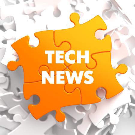 novelties: Tech News on Orange Puzzle on White Background. Stock Photo