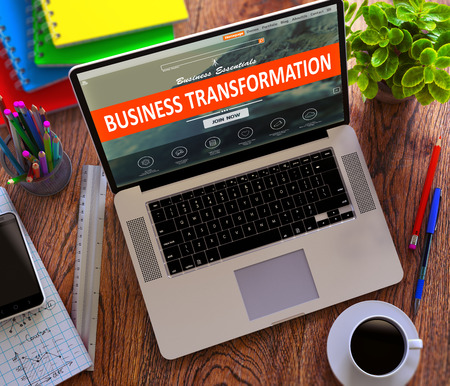 innovation growth: Business Transformation Concept. Modern Laptop and Different Office Supply on Wooden Desktop background.