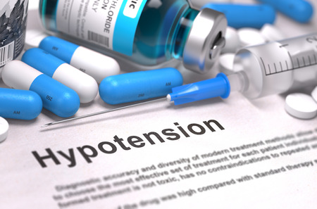 hypotension: Diagnosis - Hypotension. Medical Report with Composition of Medicaments - Blue Pills, Injections and Syringe. Blurred Background with Selective Focus.