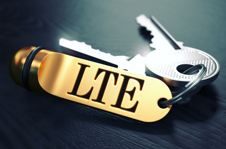 long term evolution: Keys with Word LTE - Long Term Evolution - on Golden Label over Black Wooden Background. Closeup View, Selective Focus, 3D Render. Toned Image. Stock Photo
