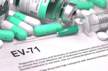 virus: EV-71 - Printed Diagnosis with Blurred Text. On Background of Medicaments Composition - Mint Green Pills, Injections and Syringe.