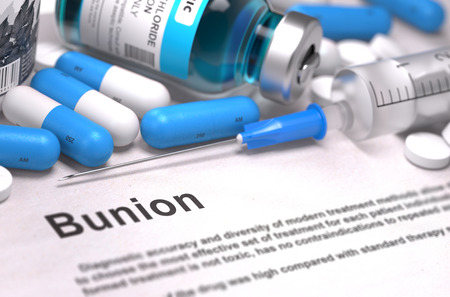 bunion: Bunion - Printed Diagnosis with Blurred Text. On Background of Medicaments Composition - Blue Pills, Injections and Syringe.