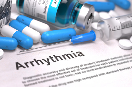 medicaments: Diagnosis - Arrhythmia. Medical Report with Composition of Medicaments - Blue Pills, Injections and Syringe. Blurred Background with Selective Focus. Stock Photo