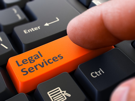 legal services: Computer User Presses Orange Button Legal Services on Black Keyboard. Closeup View. Blurred Background.