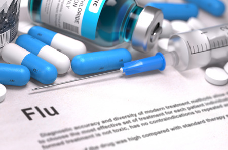 grippe: Diagnosis - Flu. Medical Concept with Blue Pills, Injections and Syringe. Selective Focus. Blurred Background. Stock Photo