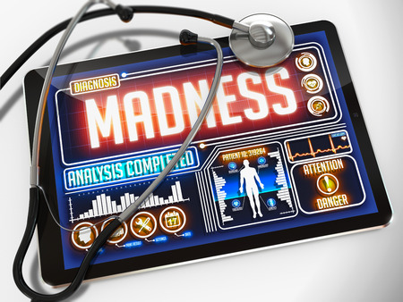 folie: Madness - Diagnosis on the Display of Medical Tablet and a Black Stethoscope on White Background.
