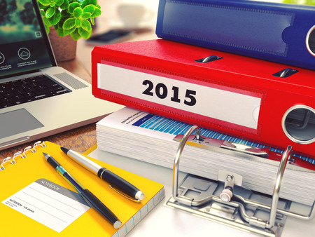 office working table background 2015 red office folder on background of working table with stock photo picture and royalty free image image 44384583
