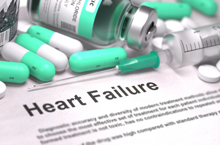 heart failure: Heart Failure - Printed Diagnosis with Mint Green Pills, Injections and Syringe. Medical Concept with Selective Focus. Stock Photo