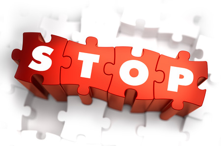 discontinue: Stop - Text on Red Puzzles with White Background. 3D Render. Stock Photo