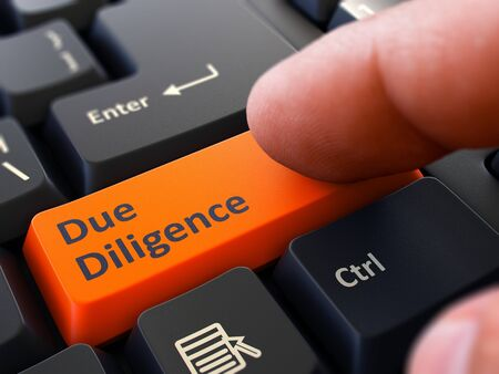 diligence: Due Diligence - Written on Orange Keyboard Key. Male Hand Presses Button on Black PC Keyboard. Closeup View. Blurred Background. Stock Photo