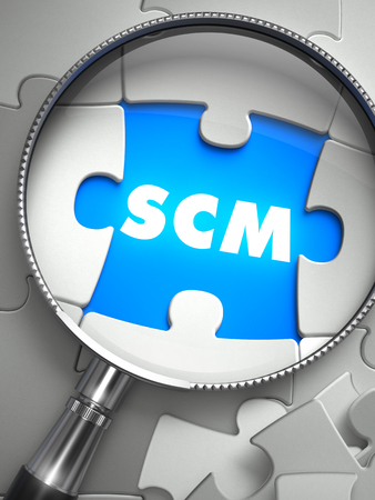 scm: SCM - Supply Chain Management - Word on the Place of Missing Puzzle Piece through Magnifier. Selective Focus.