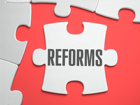 reformer: Reforms - Text on Puzzle on the Place of Missing Pieces. Scarlett Background. Close-up. 3d Illustration. Stock Photo