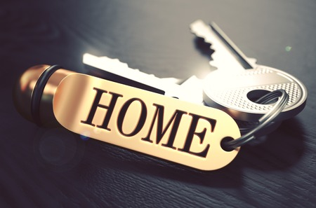 key words: Keys and Golden Keyring with the Word Home over Black Wooden Table with Blur Effect. Toned Image. Stock Photo