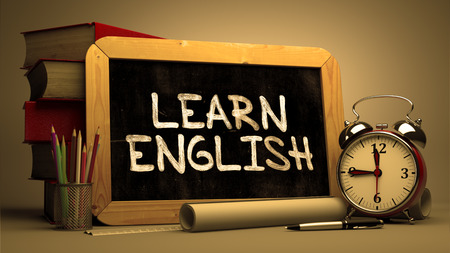 learn english: Learn English Concept Hand Drawn on Chalkboard. Blurred Background. Toned Image.