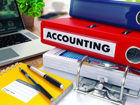 Accounting - Red Ring Binder on Office Desktop with Office Supplies and Modern Laptop. Business Concept on Blurred Background. Toned Illustration. 写真素材