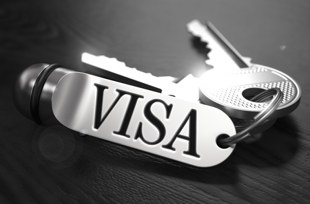 keyring: Visa Concept. Keys with Keyring on Black Wooden Table. Closeup View, Selective Focus, 3D Render. Black and White Image. Stock Photo