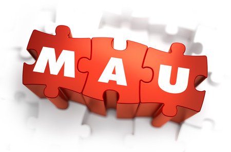 active content: Word - MAU -Monthly Active Users - on Red Puzzles with White Background. 3D Render. Stock Photo