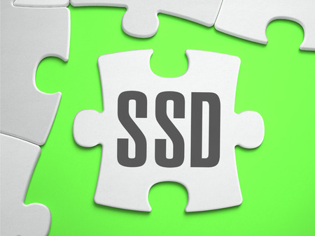 ssd: SSD - Solid State Disk - Jigsaw Puzzle with Missing Pieces. Bright Green Background. Close-up. 3d Illustration. Stock Photo