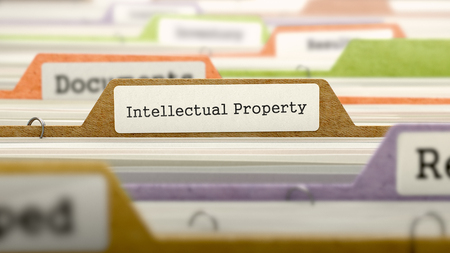 Intellectual Property - Folder Register Name in Directory. Colored, Blurred Image. Closeup View. Standard-Bild