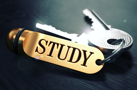 factual: Keys with Word Study on Golden Label over Black Wooden Background. Closeup View, Selective Focus, 3D Render. Toned Image. Stock Photo