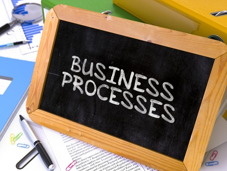 formalization: Hand Drawn Business Processes Concept  on Chalkboard. Blurred Background. Toned Image. Stock Photo