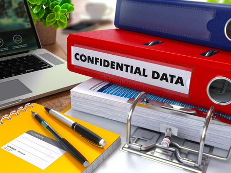 thievery: Red Ring Binder with Inscription Confidential Data on Background of Working Table with Office Supplies, Laptop, Reports. Toned Illustration. Business Concept on Blurred Background.