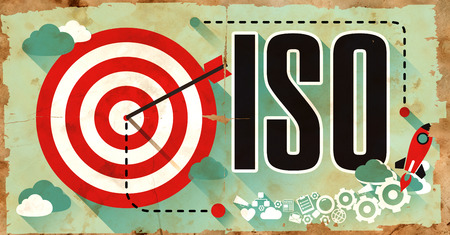 standardization: ISO -  International Organization Standardization - Concept on Old Poster in Flat Design with Red Target, Rocket and Arrow. Business Concept. Stock Photo