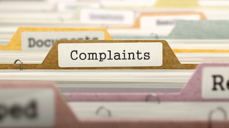 complaints: Complaints - Folder Register Name in Directory. Colored, Blurred Image. Closeup View. Stock Photo