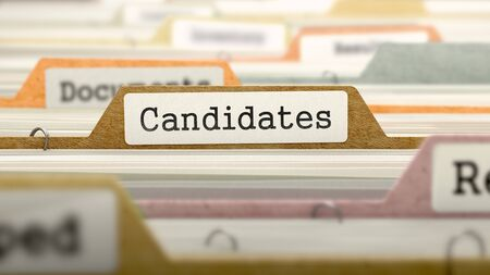 Candidates on Business Folder in Multicolor Card Index. Closeup View. Blurred Image. Stock Photo
