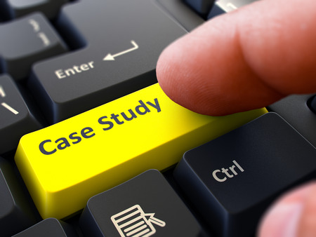 factual: Case Study Button. Male Finger Clicks on Yellow Button on Black Keyboard. Closeup View. Blurred Background.
