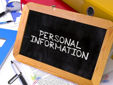 personal information: Personal Information Handwritten on Chalkboard. Composition with Small Chalkboard on Background of Working Table with Ring Binders, Office Supplies, Reports. Blurred Background. Toned Image. Stock Photo