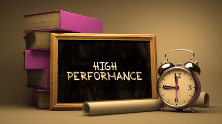 high performance: Handwritten High Performance on a Chalkboard. Composition with Chalkboard and Stack of Books, Alarm Clock and Rolls of Paper on Blurred Background. Toned Image. Stock Photo